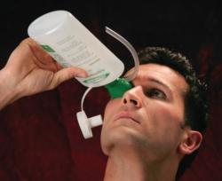 Eye wash bottle with eye cup